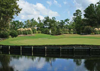 photo the golf course and clubhouse in Legend Oaks